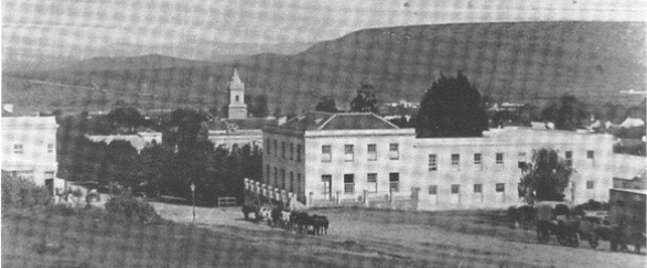 Dolley's shop is on the left with the Riebeek Hostel for Seniors and Staff on the top floor. On the right is Riebeek College with the school on the ground floor and the hostel on the top floor (Steytler House). The building is now called Granville Mansions on the corner of Cannon and Church Street.